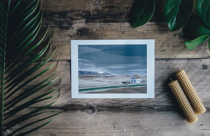 A flat lay of a landscape photo print and foliage on a wooden table - how to enlarge photos for printing